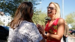 U.S. Senate candidate Kyrsten Sinema, D-Ariz., speaks to a supporter at the Barton Barr Central Library, Tuesday, Nov. 6, 2018, in Phoenix. (AP Photo/Rick Scuteri)