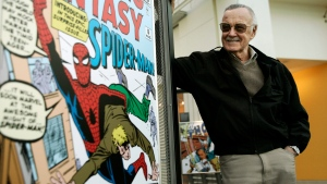 In this March 21, 2006 file photo, comic book creator Stan Lee stands beside some of his drawings in the Marvel Super Heroes Science Exhibition at the California Science Center in Los Angeles. (AP Photo/Damian Dovarganes)