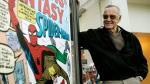 Comic book creator Stan Lee stands beside some of his drawings in the Marvel Super Heroes Science Exhibition at the California Science Center in Los Angeles Tuesday, March 21, 2006. (AP Photo/Damian Dovarganes)