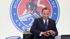 NHL commissioner Gary Bettman, left, joins Hockey Hall of Fame inductees, from left to right, Alexander Yakushev, Martin St. Louis, Martin Brodeur, Jayna Hefford and Willie O'Ree for a ceremony prior to NHL action between the Toronto Maple Leafs and the New Jersey Devils, in Toronto on Friday, Nov. 9, 2018. THE CANADIAN PRESS/Frank Gunn