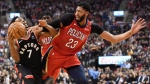 Toronto Raptors guard Kyle Lowry (7) and New Orleans Pelicans forward Anthony Davis (23) battle for the ball during first half NBA basketball action in Toronto on Monday, November 12, 2018. (THE CANADIAN PRESS/Nathan Denette)