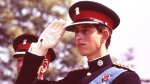 Prince Charles, the Prince of Wales, in the uniform of the Colonel in Chief of the Royal Regiment of Wales, salutes during the Regiment's Colour presentation, at Cardiff Castle in Wales, June 11, 1969. (AP Photo)