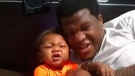 This photo provided by Avontea Boose shows her baby Tristan Roberson and the boy's father Jemel Roberson. (Avontea Boose via AP)