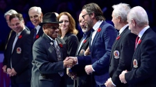 Hockey Hall of Fame inductee Willie O'Ree shakes hands with HHoF personalities before NHL action between the Toronto Maple Leafs and the New Jersey Devils, in Toronto on Friday, Nov. 9, 2018. (THE CANADIAN PRESS/Frank Gunn)