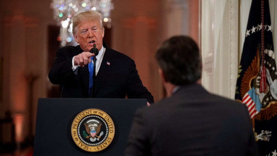 U.S. President Donald Trump speaks to CNN journalist Jim Acosta during a news conference in the East Room of the White House, Wednesday, Nov. 7, 2018, in Washington. (AP Photo/Evan Vucci)