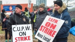 Canada Post workers walk the picket line as a rotating strike continues in Halifax on Tuesday, Nov. 13, 2018. Union negotiators say there was little progress during the two-and-a-half weeks that a special mediator was assigned to the Canada Post labour dispute. (THE CANADIAN PRESS/Andrew Vaughan)