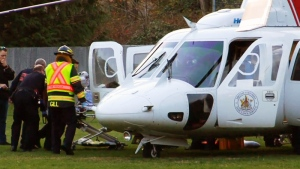 The victim of a shooting in Abbotsford is loaded onto an air ambulance on Monday, Nov. 12, 2018.