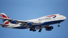 In this Feb. 8, 2016 file photo, a British Airways plane lands on a runway at Denver International Airport. (AP Photo/David Zalubowski, File)