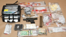 Officials seized, drugs, cash and a loaded gun from a location on Kathleen Avenue on Friday, Nov. 9, 2018. (Source: London Police Service)