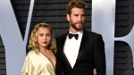 In this March 4, 2018 file photo, Miley Cyrus, left, and Liam Hemsworth arrive at the Vanity Fair Oscar Party in Beverly Hills, Calif. (Photo by Evan Agostini/Invision/AP, FIle)