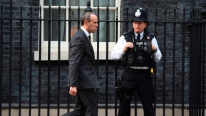 Britain's Secretary of State for Exiting the European Union Dominic Raab, leaves after a cabinet meeting at 10 Downing Street in London, Tuesday, Nov. 13, 2018. (Victoria Jones/PA via AP)