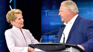 Former Ontario Liberal Leader Kathleen Wynne, left, and Ontario Progressive Conservative Leader Doug Ford shake hands following the end of the third and final televised debate of the provincial election campaign in Toronto, Sunday, May 27, 2018. (THE CANADIAN PRESS/Frank Gunn)