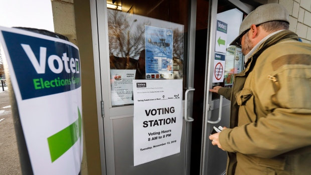 Calgarians arrive to vote in a plebiscite on whether the city should proceed with a bid for the 2026 Winter Olympics, in Calgary, Alta., Tuesday, Nov. 13, 2018. (THE CANADIAN PRESS/Jeff McIntosh)