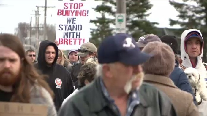 Tuesday, than 50 people gathered outside Glace Bay High School to show their support for 14-year-old Brett Corbett.