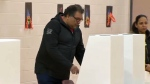 Mayor Naheed Nenshi casts his ballot during the November 13, 2018 plebiscite on hosting the Olympics