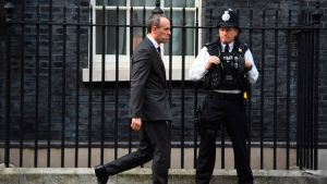 Britain's Secretary of State for Exiting the European Union Dominic Raab, leaves after a cabinet meeting at 10 Downing Street in London, Tuesday, Nov. 13, 2018. Negotiators from Britain and the European Union have struck a proposed divorce deal that will be presented to politicians on both sides for approval, officials in London and Brussels said Tuesday. (Victoria Jones/PA via AP)