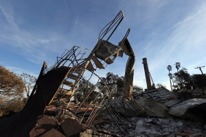 The ruins of a spiral staircase and a chimney are seen at a home destroyed by the Woolsey Fire on Dume Drive in the Point Dume area of Malibu in Southern California, Tuesday, Nov. 13, 2018. (AP Photo/Reed Saxon)