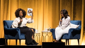 "Oprah Winfrey, left, interviews former first lady Michelle Obama during a kickoff event for Obama's new book ""Becoming"" at the United Center in Chicago, Tuesday night, Nov. 13, 2018. (Ashlee Rezin/Chicago Sun-Times via AP)"