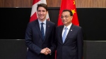 Prime Minister Justin Trudeau meets with Chinese Premier Li Keqiang before the Canada-China Annual Leaders dialogue in Singapore on Wednesday, Nov. 14, 2018. (Adrian Wyld / THE CANADIAN PRESS)