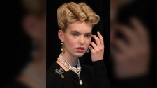 A model wears 'Queen Marie Antoinette's Pearl' on Marie Antoinette's pearl and diamond necklace, with the French queen's diamond brooch (L), pearl and diamond pendant earrings and a diamond and woven hair ring, at a photocall at Sotheby's auction house in London on October 19, 2018. (DANIEL LEAL-OLIVAS / AFP)