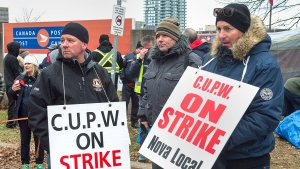 Canada Post workers walk the picket line as a rotating strike continues in Halifax on Tuesday, Nov. 13, 2018. Union negotiators say there was little progress during the two-and-a-half weeks that a special mediator was assigned to the Canada Post labour dispute. THE CANADIAN PRESS/Andrew Vaughan