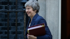 British Prime Minister Theresa May smiles as she leaves 10 Downing Street heading to Parliament for Prime Minister's questions in London, Wednesday, Nov. 14, 2018. (AP / Matt Dunham)
