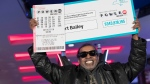 Robert Bailey poses for photographers during a news conference at the Resorts World Casino New York City, Wednesday, Nov. 14, 2018, in New York. The retired government worker won over $343 million in Powerball, the biggest jackpot in New York state lottery history. (AP Photo/Mary Altaffer)