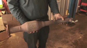 Sudbury mechanic holds catalytic converter. Nov. 14/18 (CTV Northern Ontario)
