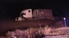 A truck sits in a farm field following a fatal two-vehicle crash on County Road 84 near Thamesford, Ont. on Wednesday, Nov. 14, 2018. (Gerry Dewan / CTV London)