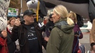 McKenna stopped to speak with pipeline protesters in Victoria's Centennial Square as members confronted her with signs and megaphones. Nov. 14, 2018. (CTV Vancouver Island)