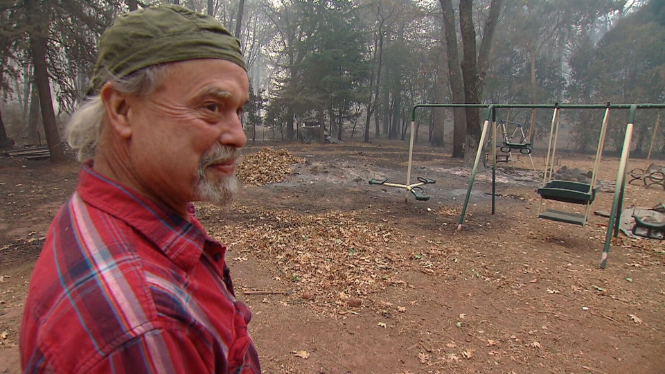 Brad Weldon looks over the destruction the Camp wildfire caused near his home in Paradise, California.