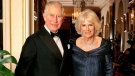 In this handout photo provided by Clarence House, Britain's Prince Charles and Camilla, Duchess of Cornwall leave Clarence House to attend a party at Buckingham Palace for Charles' 70th birthday party, in London, Wednesday, Nov. 14, 2018. (Chris Jackson / Clarence House via AP)