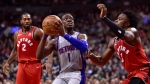 Detroit Pistons guard Reggie Jackson (1) looks the basket as Toronto Raptors forward OG Anunoby (3) defends during second half NBA basketball action in Toronto on Wednesday, Nov. 14, 2018. THE CANADIAN PRESS/Frank Gunn