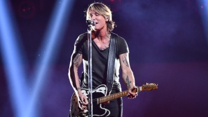 "Keith Urban performs ""Never Comin' Down"" at the 52nd annual CMA Awards at Bridgestone Arena on Wednesday, Nov. 14, 2018, in Nashville, Tenn. (Photo by Charles Sykes/Invision/AP)"