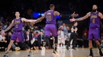 Los Angeles Lakers forward LeBron James, center, is congratulated after scoring by guard Lonzo Ball, left, and center Tyson Chandler during the second half of an NBA basketball game Wednesday, Nov. 14, 2018, in Los Angeles. The Lakers won 126-117. (AP Photo/Mark J. Terrill)