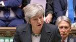 In this grab taken from video, Britain's Prime Minister Theresa May makes a statement on the draft Brexit withdrawal agreement, in the House of Commons in London, Thursday Nov. 15, 2018. Two British Cabinet ministers, including Brexit Secretary Dominic Raab, resigned Thursday in opposition to the divorce deal struck by Prime Minister Theresa May with the EU — a major blow to her authority and her ability to get the deal through Parliament. (PA via AP)