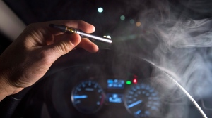 **Photo illustration** Smoke from a cannabis oil vaporizer is seen as the driver is behind the wheel of a car in North Vancouver, B.C. Wednesday, Nov. 14, 2018. Canadian police have not seen a spike in cannabis-impaired driving one month since legalization, but there needs to be more awareness of laws around storing marijuana in vehicles and passengers smoking weed, law enforcement officials say. THE CANADIAN PRESS /Jonathan Hayward