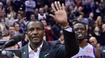 "Former Toronto Raptors coach and current coach Detroit Pistons Dwane Casey waves to the crowd during a tribute before NBA action Toronto on Wednesday Nov. 14, 2018. Casey said it was strange being back on the Toronto Raptors basketball court where he'd left so much ""blood, sweat and tears."" THE CANADIAN PRESS/Frank Gunn"