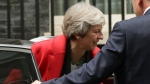 Britain's Prime Minister Theresa May returns to 10 Downing Street in London, Thursday Nov. 15, 2018. Two British Cabinet ministers, including Brexit Secretary Dominic Raab, resigned Thursday in opposition to the divorce deal struck by Prime Minister Theresa May with the EU — a major blow to her authority and her ability to get the deal through Parliament. (AP Photo/Tim Ireland)