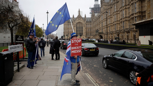 Anti-Brexit supporter Steve Bray from south Wales, protests outside the Houses of Parliament in London, Thursday Nov. 15, 2018. (AP Photo/Matt Dunham)