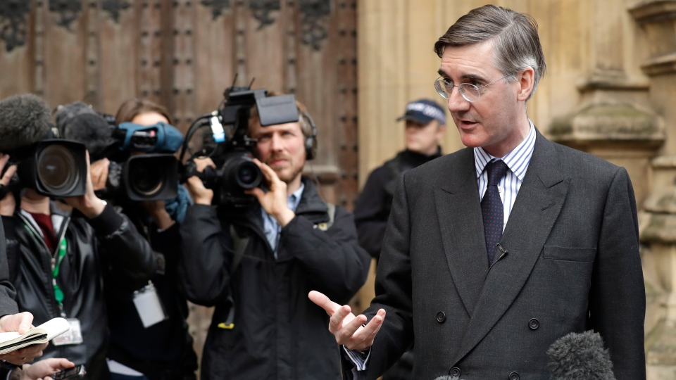 Pro-Brexit, Conservative lawmaker Jacob Rees-Mogg gestures as he speaks to the media outside the Houses of Parliament in London, Thursday, Nov. 15, 2018. (AP Photo/Matt Dunham)