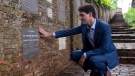 Canadian Prime Minister Justin Trudeau visits the grave stone of Esther Bernard as he visits the Fort Canning park in Singapore, Thursday November 15, 2018. THE CANADIAN PRESS/Adrian Wyld