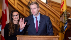 Former New Brunswick premier Brian Gallant, seen with wife Karine Gallant, announces his resignation as leader of the Liberal Party at the New Brunswick legislature on Thursday, Nov. 15, 2018, in Fredericton. (THE CANADIAN PRESS/James West)