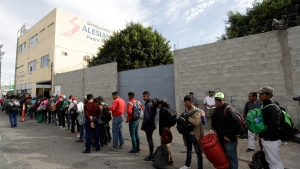 Central American migrants wait in line for a meal at a shelter in Tijuana, Mexico, Wednesday, Nov. 14, 2018. (AP / Gregory Bull)