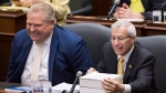 Vic Fedeli, right, Ontario Minister of Finance reads notes before tabling the government's Fall Economic Statement for 2018-2019 at Queen's Park in Toronto on Thursday, November 15, 2018. (THE CANADIAN PRESS/Nathan Denette)