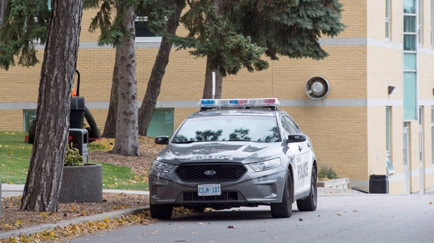 A police car is parked outside St. Michael's College School in Toronto on Thursday, November 15, 2018. THE CANADIAN PRESS/Frank Gunn