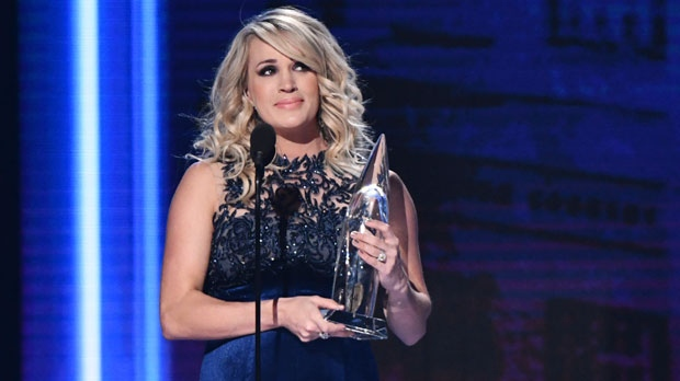 Carrie Underwood accepts the award for female vocalist of the yea at the 52nd annual CMA Awards at Bridgestone Arena on Wednesday, Nov. 14, 2018, in Nashville, Tenn. (Photo by Charles Sykes/Invision/AP)