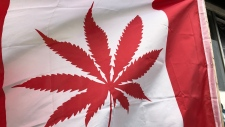 Flag outside closed Rideau Street pot dispensary