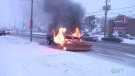 Raw: Snowplow bursts into flames