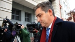 In this Nov. 14, 2018, photo, CNN's Jim Acosta walks into federal court in Washington, to attend a hearing on a legal challenge against President Donald Trump's administration. (AP Photo/Manuel Balce Ceneta)